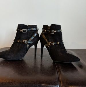 Black suede heels with adjustable studded straps